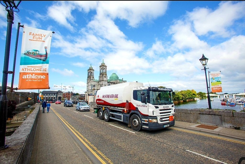 Westmeath Oil truck travels across the river Shannon in Athlone